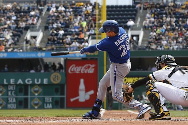 Toronto Blue Jays' Colby Rasmus, left, hits a grand slam in front of Pittsburgh Pirates catcher Chris Stewart in the second inning of the baseball game on Sunday, May 4, 2014, in Pittsburgh. (AP Photo/Keith Srakocic)