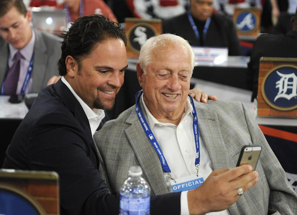 Former Los Angeles Dodgers' Mike Piazza, left, and Tommy Lasorda take a picture of themselves before the 2014 MLB baseball draft, Thursday, June 5, 2014, in Secaucus, N.J. (AP Photo/Bill Kostroun)