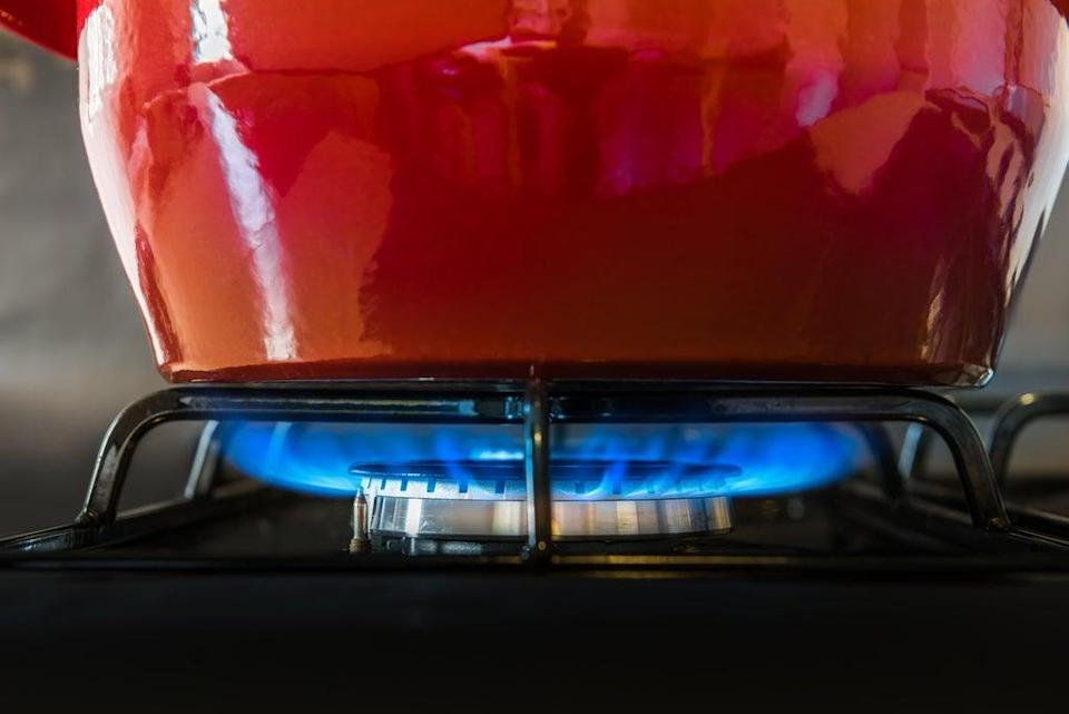 A red pot on top of a gas hob (ALAMY/PA)