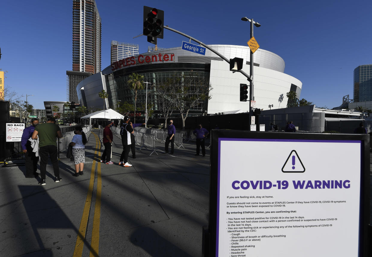 Ushers check vaccination cards at the Staples Center.