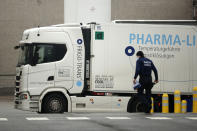 A refrigerator truck leaves the loading bays at the Pfizer Manufacturing plant in Puurs, Belgium, Wednesday, Jan. 27, 2021. The 27-nation EU is coming under criticism for the slow rollout of its vaccination campaign. The bloc, a collection of many of the richest countries in the world, is not faring well in comparison to countries like Israel, the United Kingdom and the United States. (AP Photo/Francisco Seco)