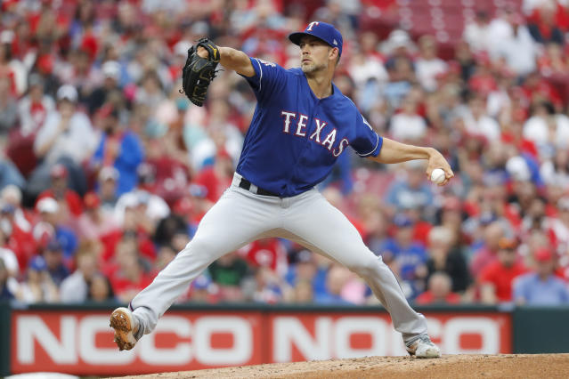 Texas Rangers starting pitcher Mike Minor throws during the first inning of the team's baseball game against the Cincinnati Reds, Saturday, June 15, 2019, in Cincinnati. (AP Photo/John Minchillo)
