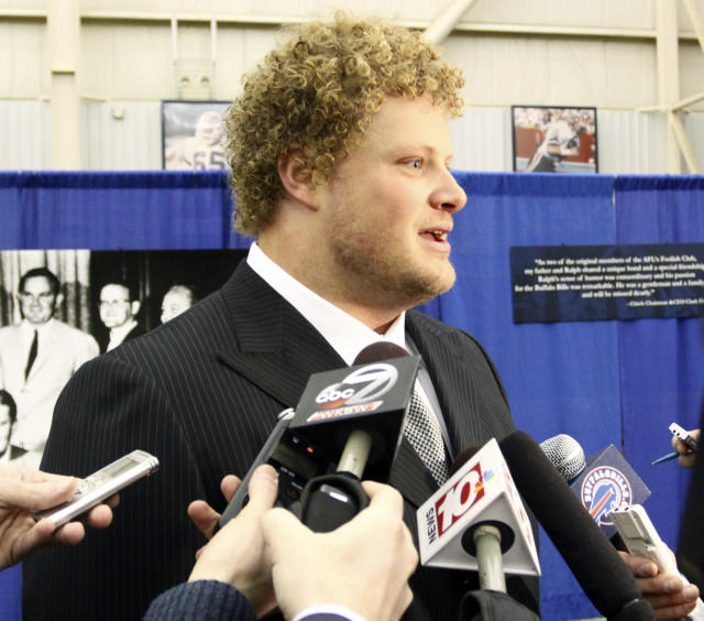 Buffalo Bills center Eric Wood answers questions from the media during a public memorial and remembrance being held inside the NFL football team's fieldhouse for Buffalo Bills owner Ralph C. Wilson in Orchard Park, N.Y., Saturday, April 5, 2014. Wilson, the team's founder and sole owner, died March 25. (AP Photo/Nick LoVerde)