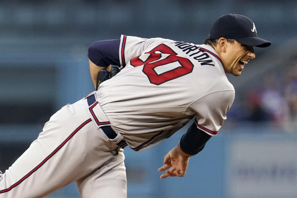 Atlanta Braves starting pitcher Charlie Morton watches a throw during the first inning of the team's baseball game against the Los Angeles Dodgers on Tuesday, Aug. 31, 2021, in Los Angeles. (AP Photo/Marcio Jose Sanchez)