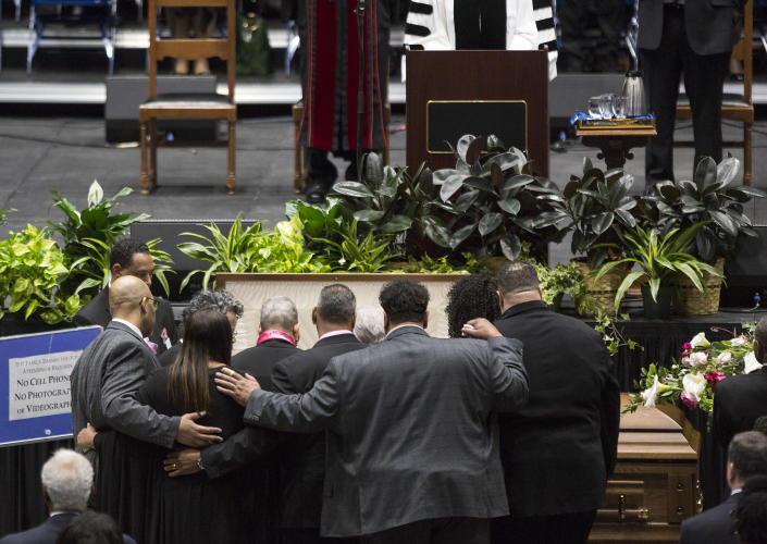 """Family members gather around the casket of Katherine Johnson at the start of a memorial service in her honor on Saturday, March 7, 2020, at Hampton University Convocation Center in Hampton, Va. Johnson, a mathematician who calculated rocket trajectories and earth orbits for NASA's early space missions and was later portrayed in the 2016 hit film """"Hidden Figures,"""" about pioneering black female aerospace workers died on Monday, Feb. 24, 2020. She was 101. (Kaitlin McKeown /The Virginian-Pilot via AP)"""