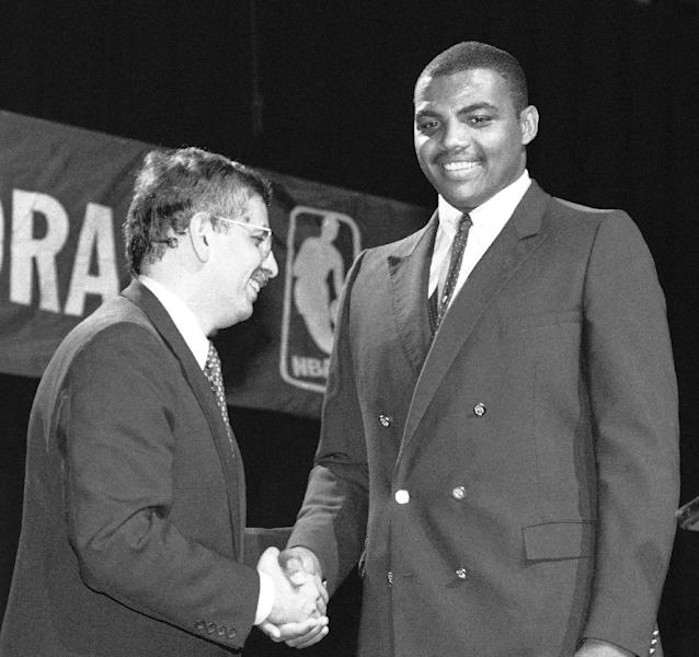 FILE - In this June 19, 1984, file photo, NBA Commissioner David Stern, left, shakes Charles Barkley's hand in New York, after the former Auburn University forward was drafted by the Philadelphia 76ers. Barkley was picked fifth in the NBA draft. Stern is not in the Hall of Fame, he never played in an All-Star game and he is about a foot shorter than most NBA stars. But try to find an NBA legacy more lasting than Stern's, who is retiring Saturday, Feb. 1, 2014 after exactly 30 years on the job. (AP Photo/Marty Lederhandler, File)