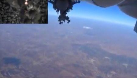 Frame grab shows a Russian military jet dropping bombs during airstrikes carried out by the country's air force near Idlib