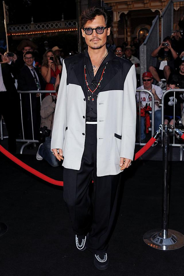 """<a href=""""http://movies.yahoo.com/movie/contributor/1800019485"""">Johnny Depp</a> attends the Disneyland premiere of <a href=""""http://movies.yahoo.com/movie/1809791042/info"""">Pirates of the Caribbean: On Stranger Tides</a> on May 7, 2011."""