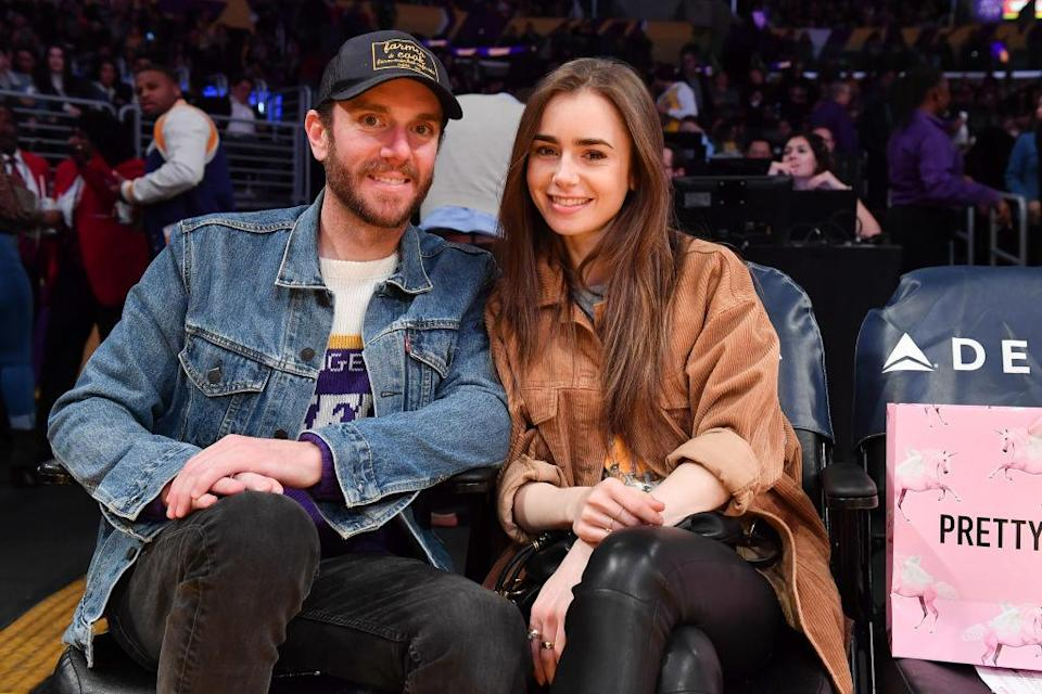 LOS ANGELES, CALIFORNIA - JANUARY 13: Lily Collins and Charlie McDowell attend a basketball game between the Los Angeles Lakers and the Cleveland Cavaliers at Staples Center on January 13, 2020 in Los Angeles, California. (Photo by Allen Berezovsky/Getty Images)