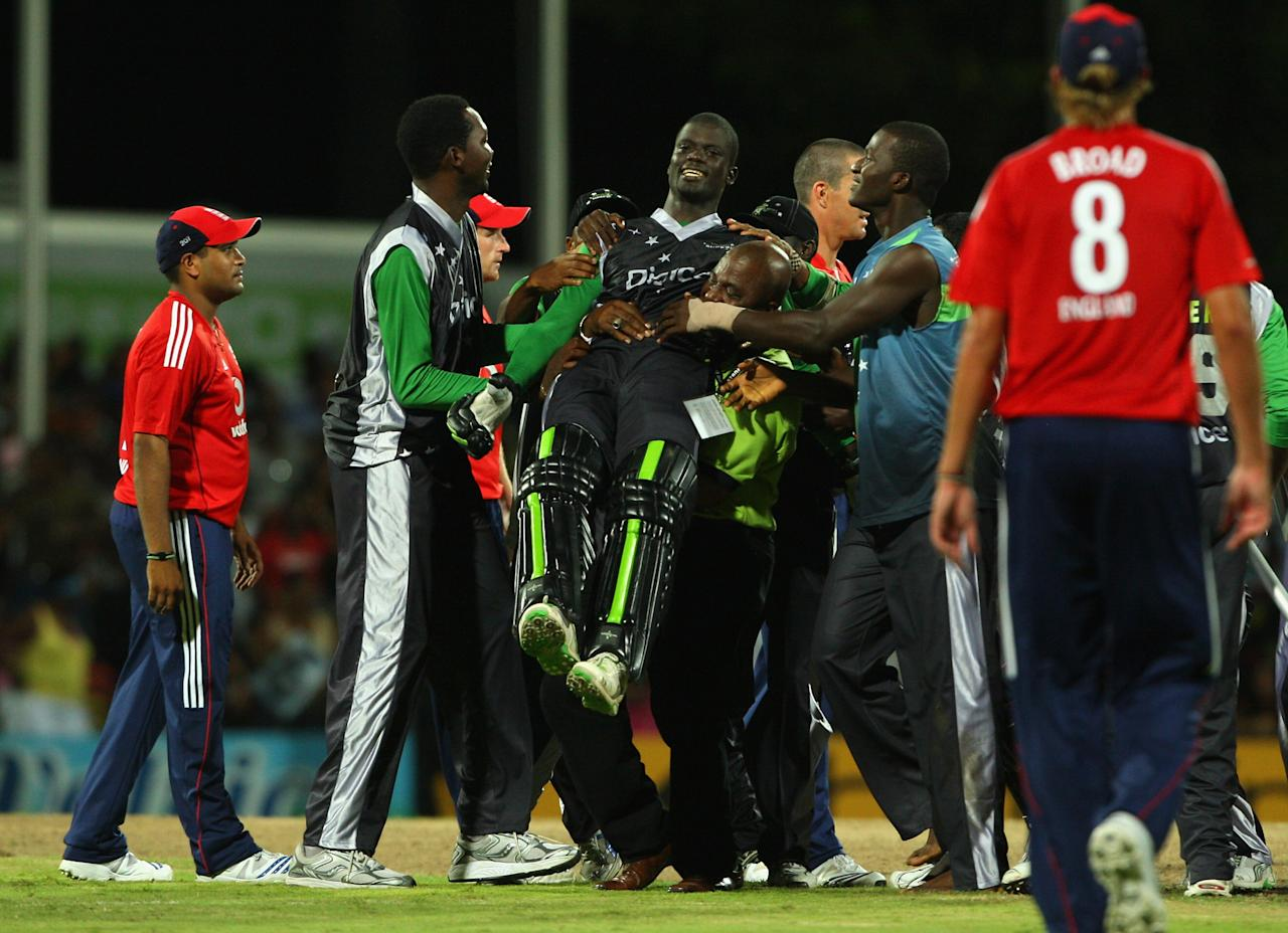 ST. JOHN'S, ANTIGUA AND BARBUDA - NOVEMBER 01: Andre Fletcher of the Superstars celebrates winning the match during the Stanford Twenty20 Super Series 20/20 for 20 match between Stamford Superstars and England at the Stanford Cricket Ground on November 1, 2008 in St Johns, Antigua. (Photo by Tom Shaw/Getty Images)