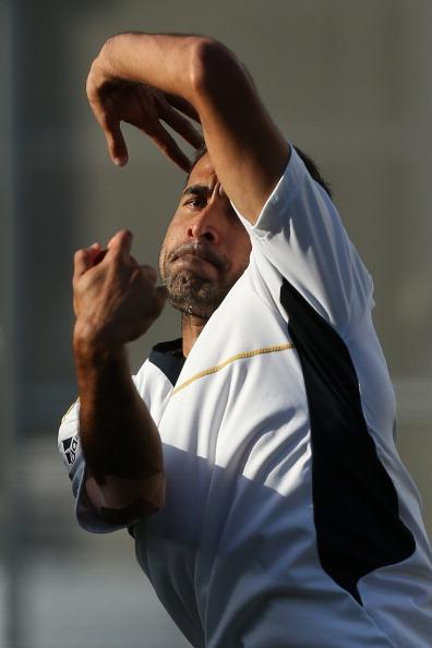 BRISBANE, AUSTRALIA - NOVEMBER 07:  Imran Tahir bowls during a South African nets session at The Gabba on November 7, 2012 in Brisbane, Australia.  (Photo by Chris Hyde/Getty Images)