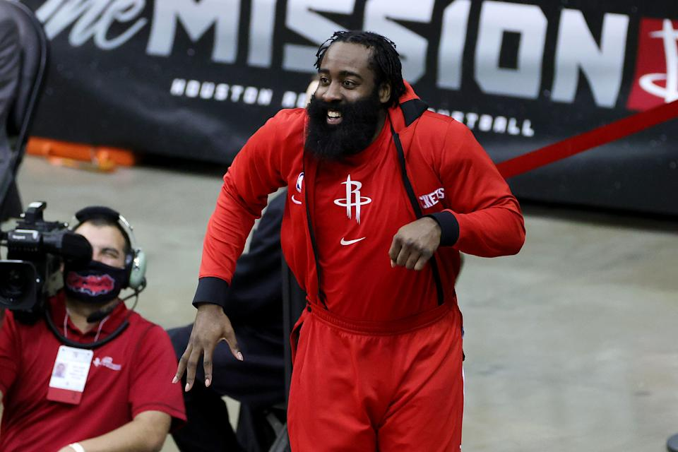 James Harden reacts on the bench during a game.