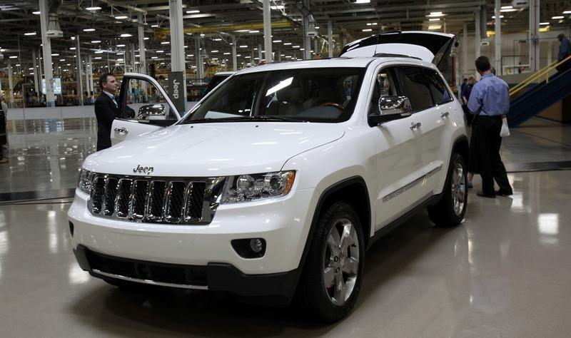 A 2011 all-new production Jeep Grand Cherokee sits inside the atrium of the new body shop at the Jefferson North Assembly Plant in Detroit,