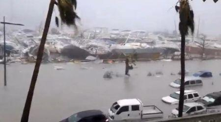 General view of half-submerged vehicles, boats and debris in the flooded harbour as Hurricane Irma  hits the French island territory of Saint Martin September 6, 2017, in this video grab made from footage taken from social media.  Mandatory credit RCI GUADELOUPE/Handout via REUTERS