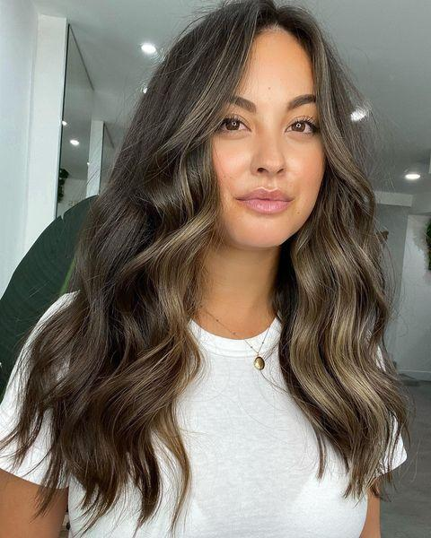 """<p>The perfect middle ground between warm and cool tones, this ash-brown hair color has a touch of brightness around the face. BTW: When it comes to preserving your new color, make sure you <strong>invest in a <a href=""""https://www.cosmopolitan.com/style-beauty/beauty/g28799147/shampoo-color-treated-hair/"""" rel=""""nofollow noopener"""" target=""""_blank"""" data-ylk=""""slk:color-safe"""" class=""""link rapid-noclick-resp"""">color-safe</a> (and/or <a href=""""https://www.cosmopolitan.com/style-beauty/beauty/g28902592/best-blue-shampoo-for-brunettes/"""" rel=""""nofollow noopener"""" target=""""_blank"""" data-ylk=""""slk:color-depositing"""" class=""""link rapid-noclick-resp"""">color-depositing</a>) shampoo and conditioner </strong>to avoid brass.</p><p><a href=""""https://www.instagram.com/p/CEfKNMzniAZ/"""" rel=""""nofollow noopener"""" target=""""_blank"""" data-ylk=""""slk:See the original post on Instagram"""" class=""""link rapid-noclick-resp"""">See the original post on Instagram</a></p>"""