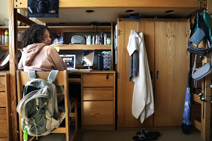 "UCLA student Kiera Laney attends a class online in her dorm room on campus in March. <span class=""copyright"">(Christina House / Los Angeles Times)</span>"