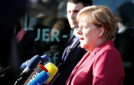 German Chancellor Angela Merkel talks to the media at Christian Democratic Union (CDU) headquarters in Berlin