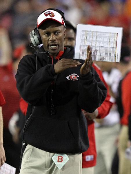 Western Kentucky head coach Willie Taggart calls a time out during overtime of an NCAA college football game against Kentucky at Commonwealth Stadium in Lexington, Ky., Saturday, Sept. 15, 2012. Western Kentucky won 32-31. (AP Photo/James Crisp)
