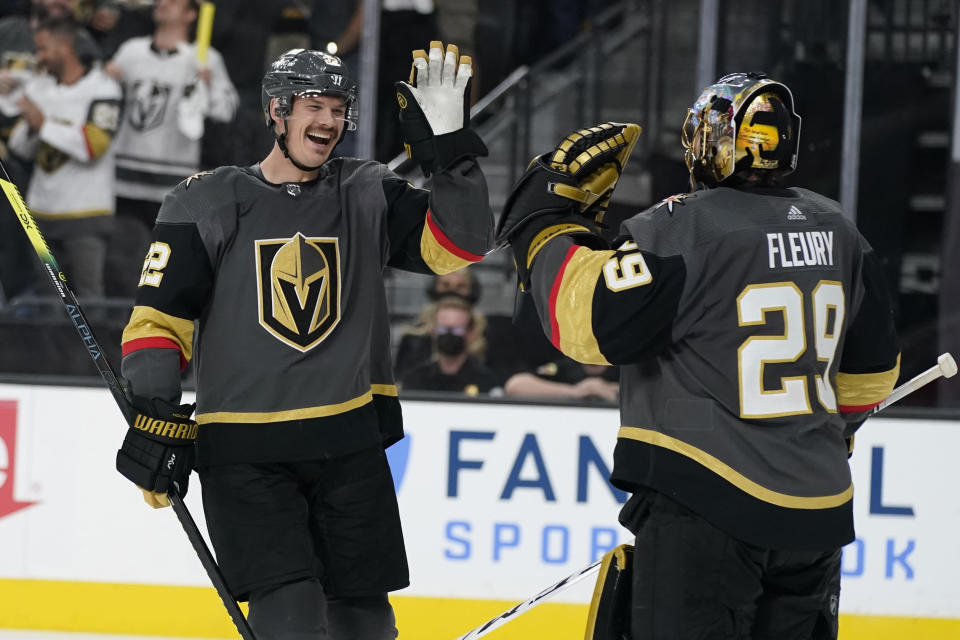 Vegas Golden Knights goaltender Marc-Andre Fleury (29) celebrates after defenseman Nick Holden, left, scored a goal against the Montreal Canadiens during the third period in Game 1 of an NHL hockey Stanley Cup semifinal playoff series Monday, June 14, 2021, in Las Vegas. (AP Photo/John Locher)