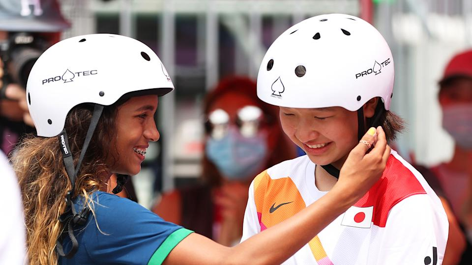 Rayssa Leal of Team Brazil puts her hand up to the face of Momiji Nishiya of Team Japan during the Women's Street Final. (Photo by Patrick Smith/Getty Images)