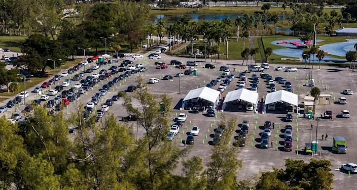 Long lines of cars wait as people with appointments get the COVID vaccine at Tropical Park test site on Saturday, Jan. 9, 2021. The Florida Highway Patrol and Miami-Dade Police urged drivers to avoid a portion of Bird Road because large crowds hoping to get the COVID-19 vaccine at the park led to traffic jams. Coronavirus numbers are surging in Miami-Dade County.
