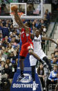 Los Angeles Clippers center DeAndre Jordan (6) grabs a rebound in front of Dallas Mavericks center Samuel Dalembert (1) during the first half of an NBA basketball game Friday, Jan. 3, 2014, in Dallas. The Clippers won 119-112. (AP Photo/Sharon Ellman)