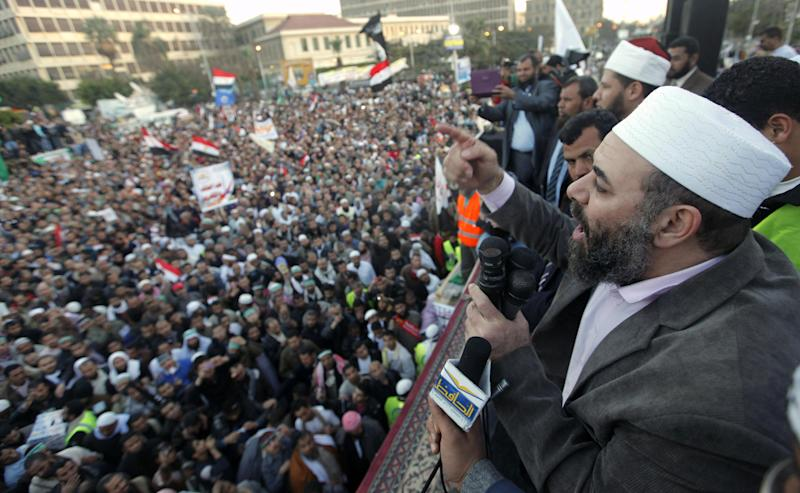 Tarek el-Zomor, a founding member of Gama'a Islamiyya, also leader and founder of the Building and Development Party, who was convicted with others of planning the assassination of late President Anwar Sadat in 1981, talks during a rally outside Cairo University in Cairo, Egypt, Friday, Feb. 15, 2013. Several thousand hard-line Islamists rallied in Cairo on Friday against a recent wave of violent anti-government protests, while liberal activists staged a smaller demonstration across town to call for accountability and justice from the country's leaders.(AP Photo/Amr Nabil)
