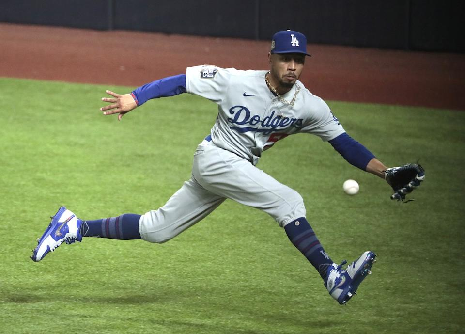 Dodgers right fielder Mookie Betts tracks down a third-inning RBI triple by Tampa Bay Rays first baseman Yandy Diaz.