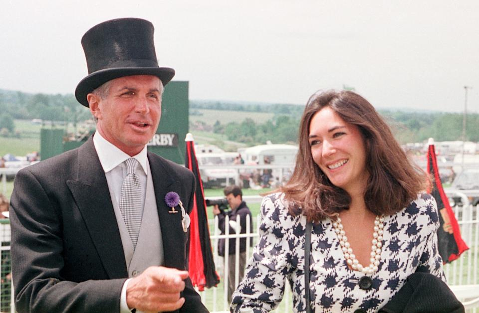 Actor George Hamilton with Ghislaine Maxwell, daughter of Robert Maxwell, arriving at Epsom.