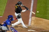 Pittsburgh Pirates' Michael Chavis singles off Chicago Cubs relief pitcher Adam Morgan, driving in a run, during the sixth inning of a baseball game in Pittsburgh, Tuesday, Sept. 28, 2021. (AP Photo/Gene J. Puskar)
