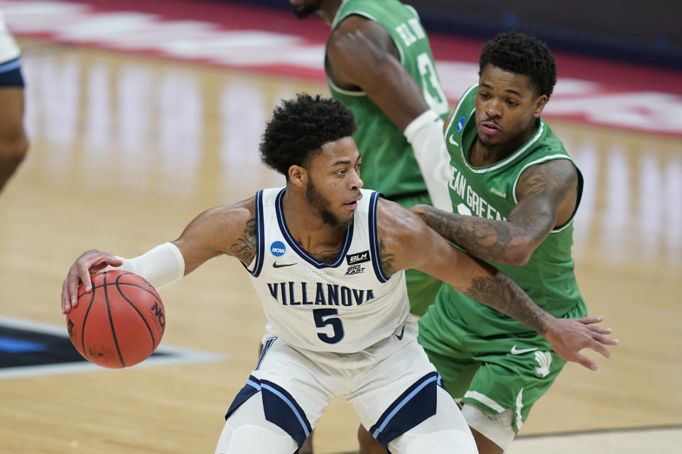 Villanova's Justin Moore (5) is defended by North Texas' Javion Hamlet (3) during the first half of a second-round game in the NCAA men's college basketball tournament at Bankers Life Fieldhouse, Sunday, March 21, 2021, in Indianapolis. (AP Photo/Darron Cummings)