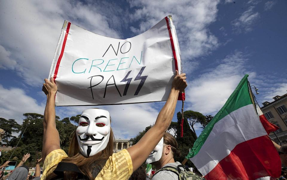 A protest in Rome against the 'green pass', a certificate proving a person has been vaccinated or has recently tested negative to Covid-19 - Shutterstock