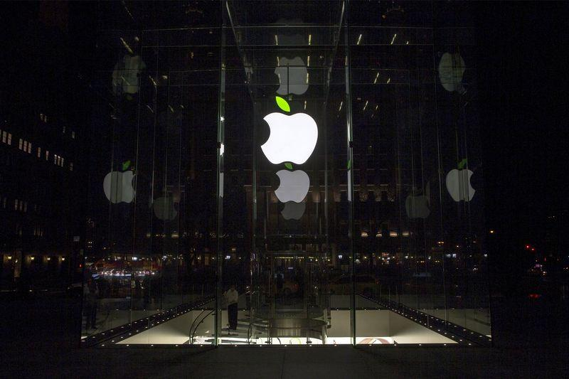 An employee cleans inside the Apple flagship store on 5th Avenue in New York