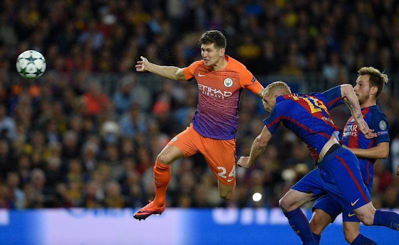 Manchester City's defender John Stones (L) vies with Barcelona's defender Jeremy Mathieu (C) beside Barcelona's midfielder Ivan Rakitic (R) during the UEFA Champions League football match FC Barcelona vs Manchester City on October 19, 2016 (AFP Photo/Lluis Gene)