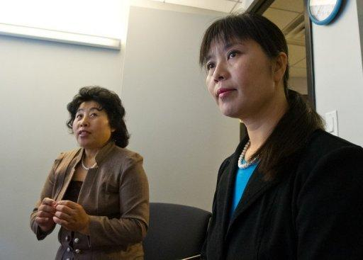 Ma Chunmei (R) and Wang Chunying are interviewed at the AFP offices in Washington, DC, on April 30, 2013. The women described their detention and torture at a Chinese labor camp for refusing to denounce Falun Gong