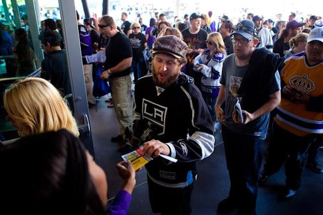 LOS ANGELES, CA - JUNE 11: Los Angeles Kings fans enter the Staples Center before the start of Game 6 of the 2012 Stanley Cup Final June 11, 2012 in Los Angeles, California. A win in Game 6 against the New Jersey Devils would lead the Los Angeles Kings to their first championship in franchise history. (Photo by Jonathan Gibby/Getty Images)