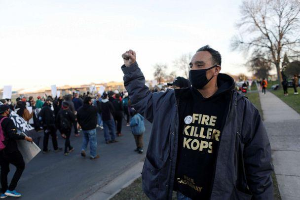 PHOTO: Gabriel 'Black' Elk holds up a fist while protesters march near the Brooklyn Center Police Department, as protests continue after former police officer Kim Potter fatally shot Daunte Wright, in Brooklyn Center, Minnesota, U.S. April 16, 2021. (Octavio Jones/Reuters)