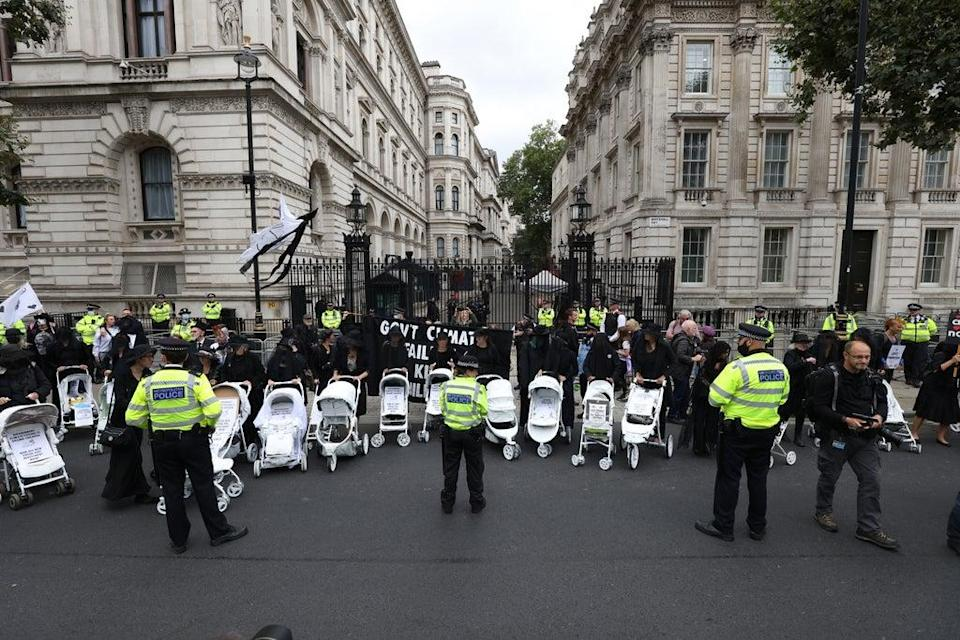Demonstrators during a protest by members of Extinction Rebellion on Whitehall, near Downing Street (James Manning/PA) (PA Wire)
