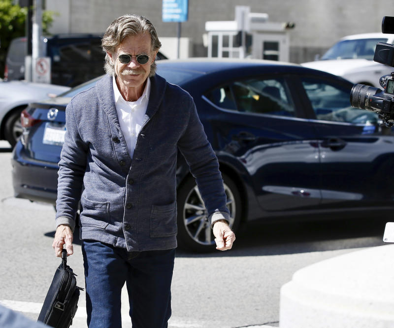 Actor William H. Macy arrives at the federal courthouse in Los Angeles, on Tuesday, March 12, 2019. Fifty people, including Macy's wife, actress Felicity Huffman and actress Lori Loughlin, were charged Tuesday in a scheme in which wealthy parents allegedly bribed college coaches and other insiders to get their children into some of the nation's most elite schools. Macy was not charged; authorities did not say why. (AP Photo/Alex Gallardo) | Alex Gallardo—AP