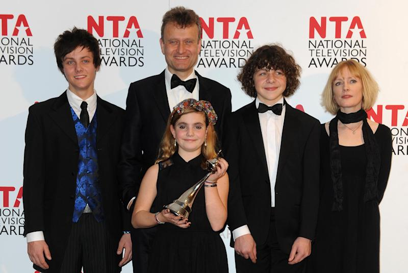 The cast of Outnumbered Tyger Drew-Honey, Hugh Dennis, Ramona Marquez, Daniel Roche and Claire Skinner with their award for Situation Comedy, backstage at the National Television Awards 2012 at the Greenwich Arena London.