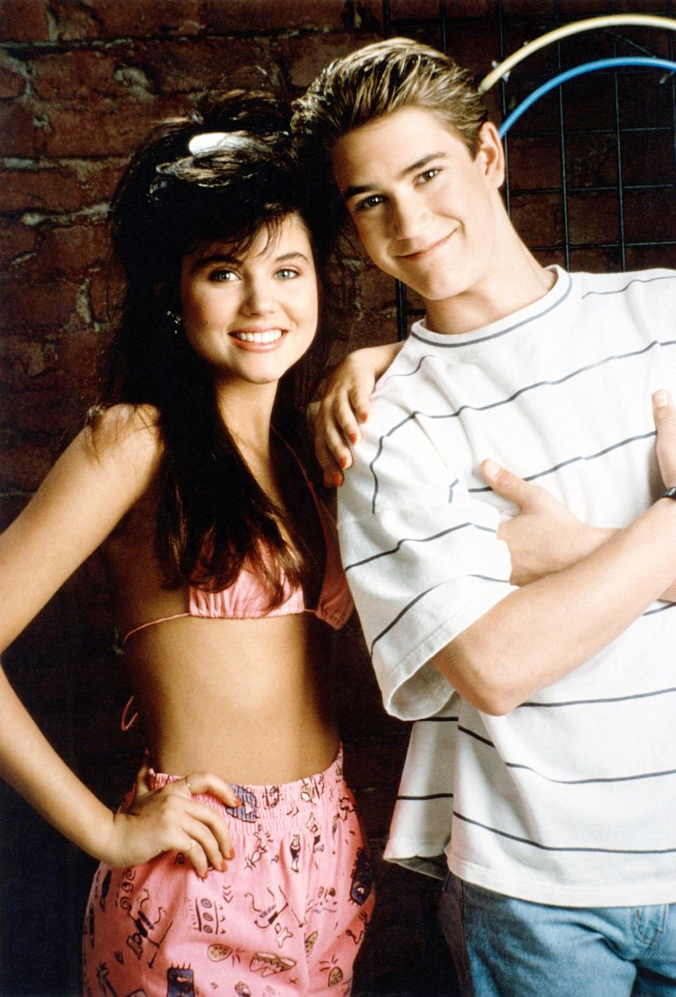 """<p>Make all the guys swoon as Kelly Kapowski from <b><a class=""""link rapid-noclick-resp"""" href=""""https://www.popsugar.co.uk/Saved-by-the-Bell"""" rel=""""nofollow noopener"""" target=""""_blank"""" data-ylk=""""slk:Saved by the Bell"""">Saved by the Bell</a></b>. You just need a white lacy bandeau top, high-waisted jeans, and suspenders. Don't forget the bangin' hairstyle!</p>"""