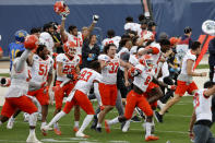 Sam Houston players celebrate as they defeat South Dakota State in the NCAA college FCS Football Championship in Frisco, Texas, Sunday, May 16, 2021. (AP Photo/Michael Ainsworth)