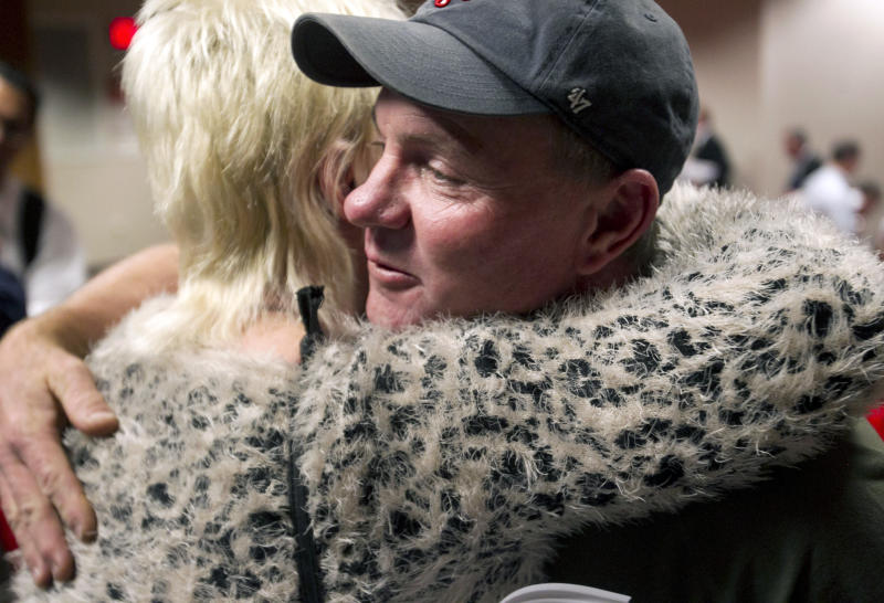 Dan Parker, right, the father of Wade Parker, who died fighting the Yarnell Hill Fire, receives a hug following an Industrial Commission of Arizona hearing on Wednesday, Dec. 4, 2013, in Phoenix. The commission approved a nearly $560,000 fine on Wednesday against the state Forestry Division in the deaths of 19 firefighters after the Arizona Division of Occupational Safety and Health agency found that officials put protection of property ahead of safety and should have pulled out crews earlier. (AP Photo/The Arizona Republic, David Wallace) MARICOPA COUNTY OUT; MAGS OUT; NO SALES