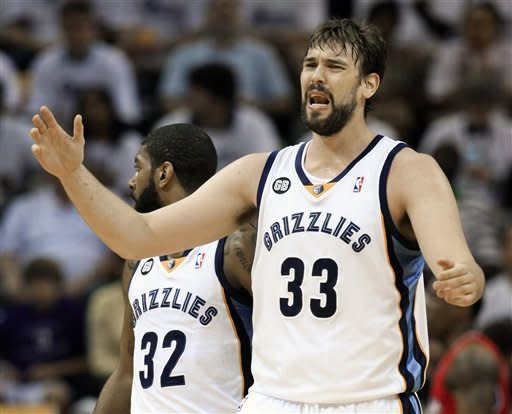 Memphis Grizzlies center Marc Gasol (33), of Spain, reacts to a foul call against him in the first half of Game 7 against the Los Angeles Clippers in a first-round NBA basketball playoff series on Sunday, May 13, 2012, in Memphis, Tenn. Grizzlies' O. J. Mayo (32) looks on. (AP Photo/Mark Humphrey)