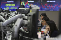 Currency traders watch monitors at the foreign exchange dealing room of the KEB Hana Bank headquarters in Seoul, South Korea, Friday, Oct. 4, 2019. Asian stocks were mixed Friday after Wall Street rebounded on investor hopes for a U.S. interest rate cut. (AP Photo/Ahn Young-joon)