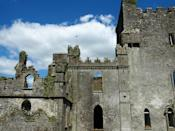 "Built somewhere between the 13th and late 15th century, this Irish castle has seen more gruesome deaths than a <a href=""https://www.cntraveler.com/galleries/2015-04-10/virtual-tour-filming-locations-game-of-thrones-season-5?mbid=synd_yahoo_rss"" rel=""nofollow noopener"" target=""_blank"" data-ylk=""slk:Game of Thrones"" class=""link rapid-noclick-resp""><em>Game of Thrones</em></a> wedding. As legend has it, during a struggle for power within the O'Carroll clan (which had a fondness for poisoning dinner guests), one brother plunged a sword into another, a priest, as he was holding mass in the castle's chapel. The room is now called ""The Bloody Chapel,"" and the priest is said to haunt the <a href=""https://www.cntraveler.com/gallery/the-most-beautiful-churches-in-the-world?mbid=synd_yahoo_rss"" rel=""nofollow noopener"" target=""_blank"" data-ylk=""slk:church"" class=""link rapid-noclick-resp"">church</a> at night. And the horror doesn't end there. During castle renovations in the early 1900s, workmen found a secret dungeon in the Bloody Chapel with so many human skeletons, they filled three cartloads when hauled away. The dungeon was designed so that prisoners would fall through a trap door, have their lungs punctured by wooded spikes on the ground, and die a slow, horrific death within earshot of the sinister clan members above."
