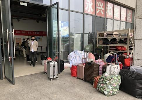 The luggage of just-arrived migrant workers sits outside Foxconn's iPhone manufacturing facility in Zhengzhou as they go through the application process. Photo: Orange Wang