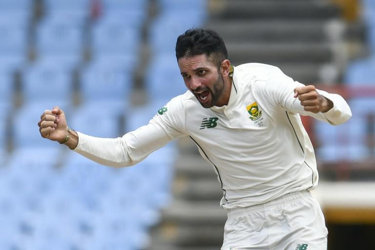 Keshav Maharaj celebrates the dismissal of Jason Holder, the middle man in his hat-trick on day 4 of the 2nd Test between South Africa and West Indies in Saint Lucia