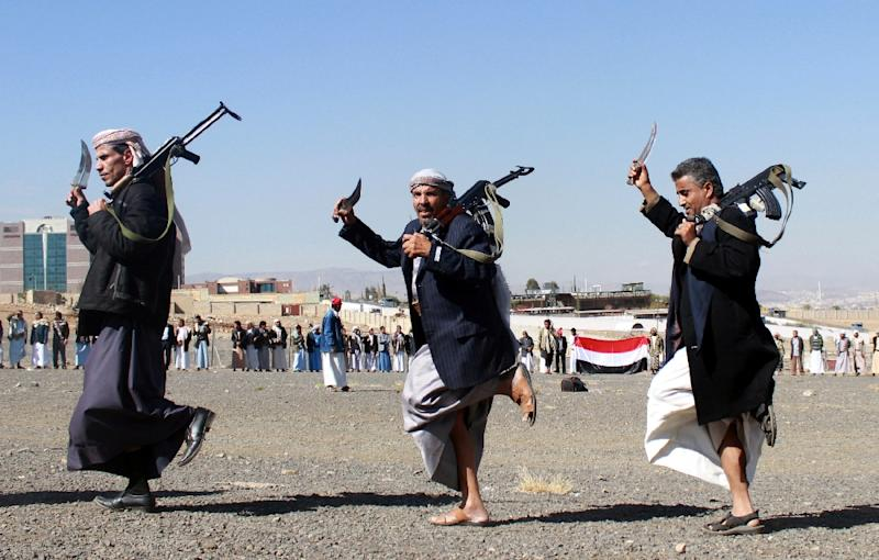 Supporters of Shiite Huthi rebels and militiamen dance with their weapons at a rally against the Arab coalition, which has been leading the war against the Iran-backed rebels, on December 14, 2015 in Sanaa (AFP Photo/Abdel Rahman Abdallah)