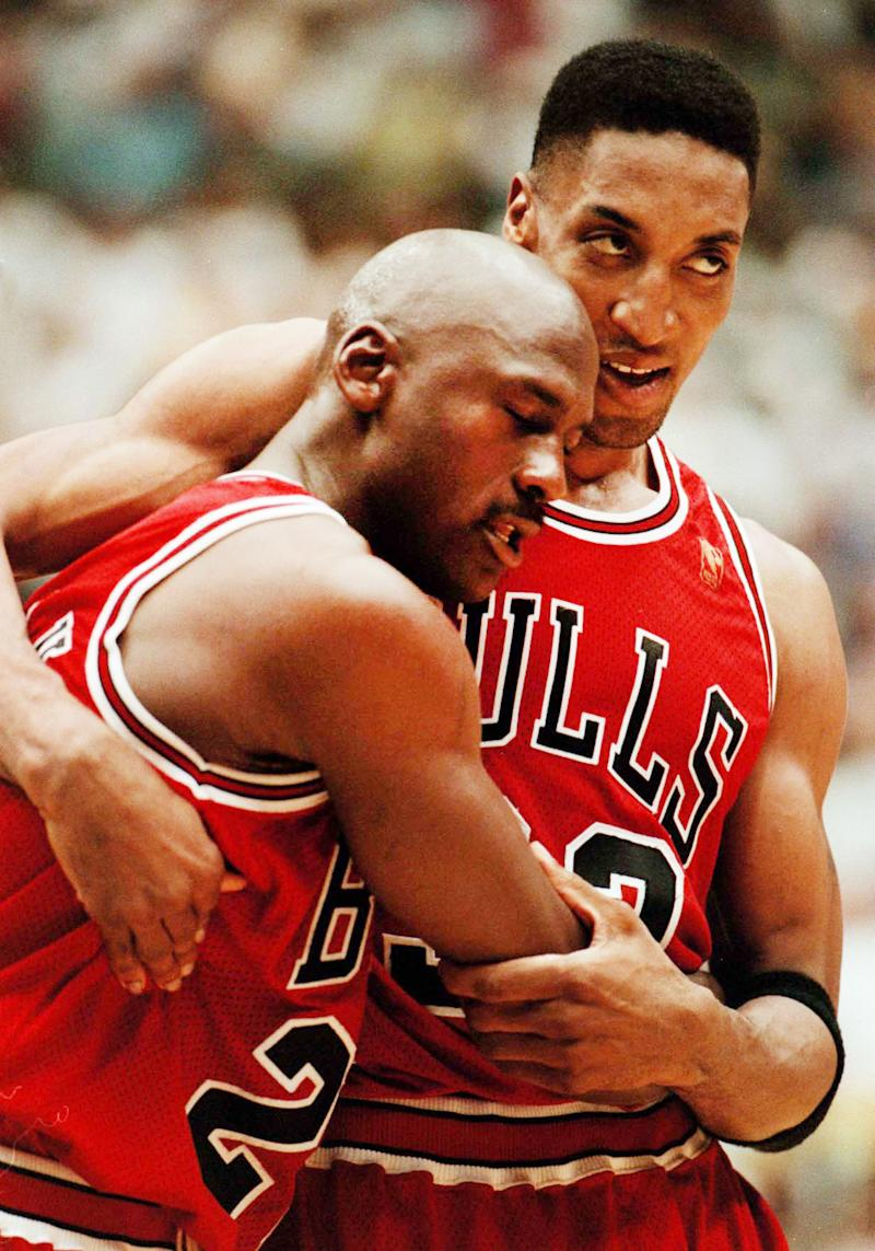 Jordan collapsed into Scottie Pippen's arms as he walked off the court during a late timeout, a sleepless night before thanks to some bad pizza in his rearview mirror and another clutch, courageous performance in his making on June 11, 1997. He finished with 38 points, seven rebounds, five assists and three steals, not to mention the game-clinching 3-pointer in his leg-wearying 44th minute. The crucial Game 5 road victory prevented the Jazz from sweeping three straight home games. Two nights later, the Bulls closed out their fifth title at the United Center. (Nuccio DiNuzzo/Chicago Tribune/Tribune News Service via Getty Images)